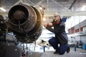 airplane mechanic working in a hot hangar