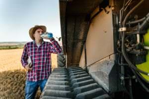 farmworker drinking water to avoid heat-related illness