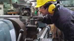 industrial worker battling heat stress in a hot factory